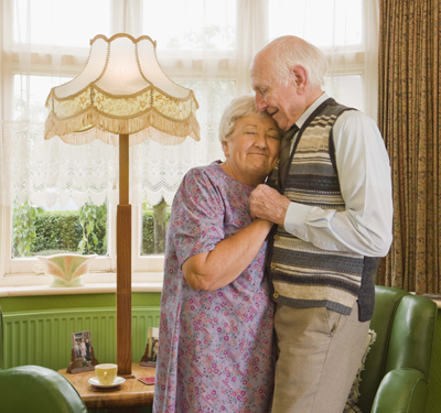 Elderly couple dancing at home