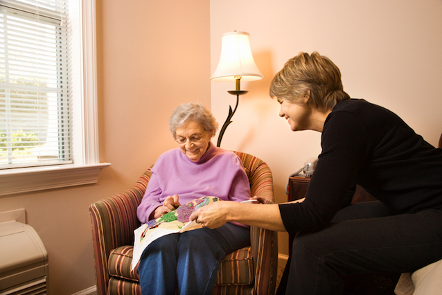 Senior Doing Needlepoint With Younger Woman