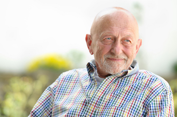 Portrait of senior man sitting looking off to side