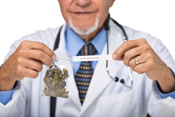 Close-up of doctor holding a bag of medical marijuana
