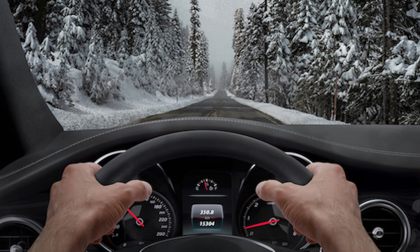 Driving in snowy weather. View from the driver angle
