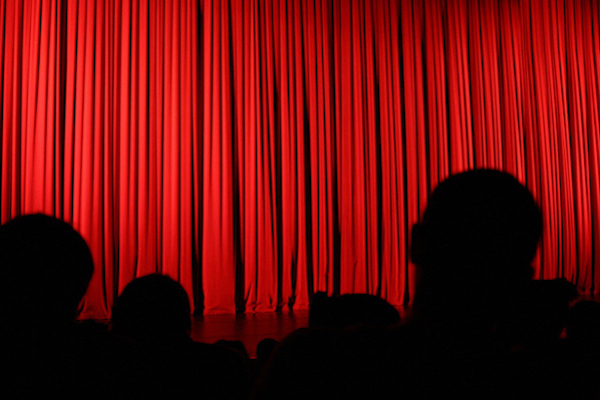 Audience silhouette and curtain