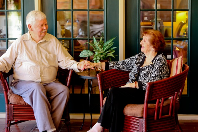 Azalea Estates of New Iberia, LA - Senior couple sitting on patio