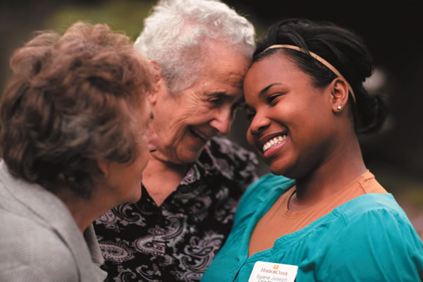 HarborChase of Auburn Hills, MI - Smiling Residents with Caregiver