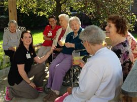 Monticello Healthcare Center, IN - Residents relaxing in courtyard