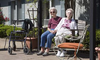 Oxton Court at Opelika, AL - Two Seniors Sitting Outside