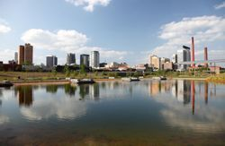 Birmingham, AL (Alabama) as seen from across a body of water.