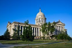 The Oklahoma state capitol sits against a deep blue sky