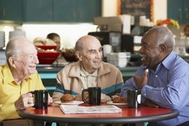 Enon Country Manor - Walnut Hill, FL - Elderly Men Chatting Over Coffee