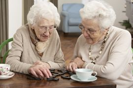 Country Manor Memory Care - Davenport, IA - Residents playing dominos