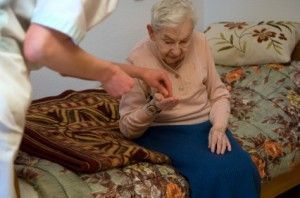 Elderly woman receiving care home services