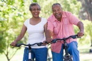 Independent senior living couple on bicycle