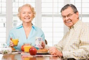 Mature couple eating breakfast.