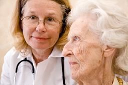 Senior receiving skilled nursing care from doctor
