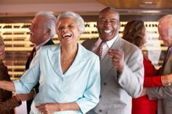 Mature dancing couple at a 55+ community