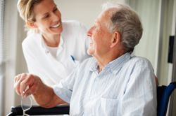 Man with Caregiver at Oak Hill Terrace - Waukesha, WI