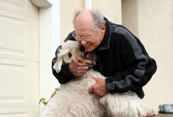 Elderly man with dog at his assisted living community