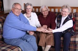 Senior prayer group at a christian retirement home