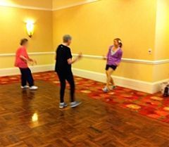 Seniors participating in a fitness class