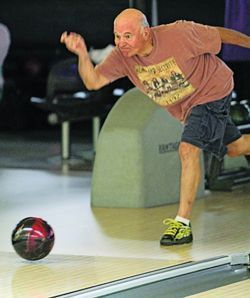 Athlete participating in bowling at the Washington State Senior Games