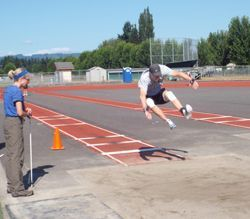 Participant Competing in the Long Jump at the Washington State Senior Games