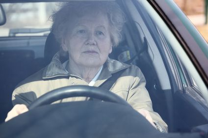Elderly woman in car